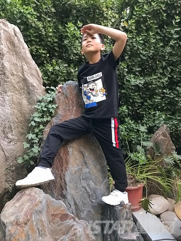 MR.HU品牌条纹饰边休闲裤